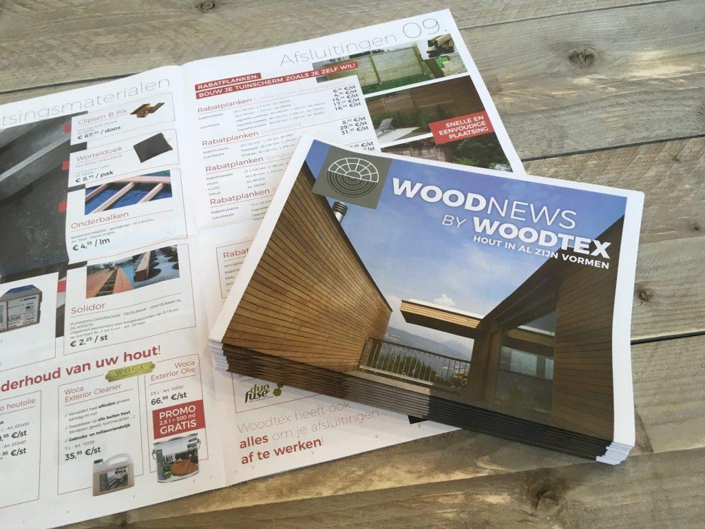 papieren krant open en dicht van houthandel woodtex